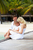 Family Sitting On Wooden Jetty — Stock Photo