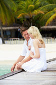 Couple Sitting On Wooden Jetty — Stock Photo
