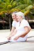 Senior Couple Sitting On Wooden Jetty — Foto Stock