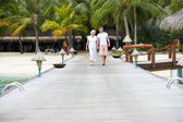 Senior Couple Walking On Wooden Jetty — ストック写真