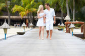 Couple Walking On Wooden Jetty — Stock Photo