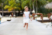 Child Running Along Wooden Jetty — Stok fotoğraf