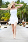 Woman Running Along Wooden Jetty — Stockfoto