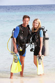 Couple With Scuba Diving Equipment Enjoying Beach Holiday — Stock Photo