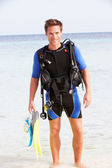 Man With Scuba Diving Equipment Enjoying Beach Holiday — Stock Photo
