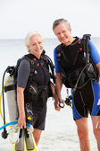 Senior Couple With Scuba Diving Equipment Enjoying Holiday — Stock Photo