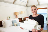 Portrait Of Hotel Chambermaid With Towels — Stock Photo