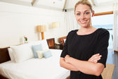 Portrait Of Hotel Chambermaid In Guest Room — Stock Photo