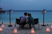 Couple Enjoying Late Meal In Outdoor Restaurant — Stock Photo
