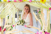 Bride Sitting Under Decorated Canopy At Wedding — Stock Photo