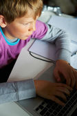 Boy Studying In Bedroom Using Laptop — 图库照片