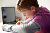 Boy Studying In Bedroom Using Laptop — Stock Photo