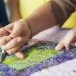 Stock Photo: Woman's Hand Sewing