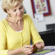 Stock Photo: Woman Sewing Quilt