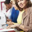 Stock Photo: Women Using Electric Sewing Machines