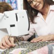 Woman Using Electric Sewing Machine — Stock Photo #36967919