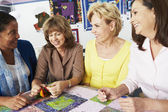 Women Making Quilt Together — Стоковое фото