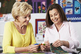 Women Sewing Quilt — Stock Photo