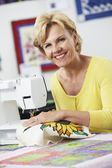 Woman Using Electric Sewing Machine — Stock Photo