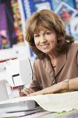 Woman Using Electric Sewing Machine — Stock Photo