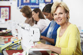 Women Using Electric Sewing Machines — Foto Stock