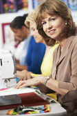 Women Using Electric Sewing Machines — Stock Photo