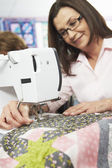 Woman Using Electric Sewing Machine — Foto Stock