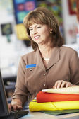 Female Cashier At Clothing Store — Stock Photo