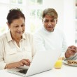 Indian Couple Using Laptop And Digital Tablet — Foto Stock