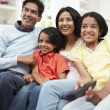 Indian Family Watching TV Together — Stock Photo