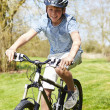Young Boy Riding Bike Along Country Track — ストック写真