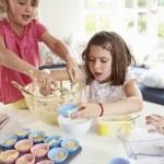 Three Girls Making Cupcakes In Kitchen — Stock Photo #36973699
