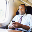 Businessman listening music — Stock Photo