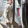 Businessman coming in train — Stock Photo