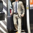 Businessman coming out of train — Stock Photo #36974115