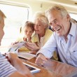 Happy family traveling by train — Stock Photo #36974399