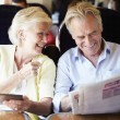 Senior couple traveling by train — Stock Photo #36974409