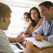Happy family traveling by train — Stock Photo #36974425