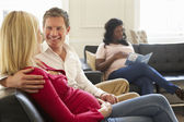 Couples In Waiting Room — Stockfoto