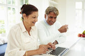 Indian Couple Using Laptop And Digital Tablet — Stock Photo
