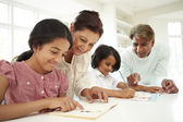 Grandparents Helping Children With Homework — Stock Photo