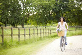 Indian Woman On Cycle Ride In Countryside — Stock Photo