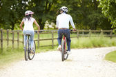 Indian Couple On Cycle Ride In Countryside — Stock Photo