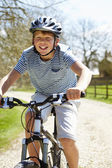 Young Boy Riding Bike Along Country Track — Stock Photo