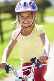 Young Girl Riding Bike Along Country Track — Stok fotoğraf