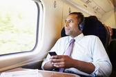Biznesmen słuchania muzyki — Zdjęcie stockowe