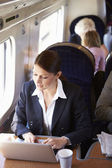 Businesswoman traveling — Stockfoto