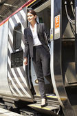 Businesswoman on a train trap — Stock Photo