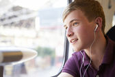 Teenager boy listening music — Stock Photo