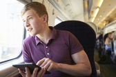 Teenager boy reading ebook — Stock Photo
